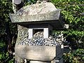 Stone latern with stones at Zenkoji.jpg