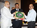Sushil Kumar Shinde presented the Census Medals, at the release of the Primary Census Abstract- Data Highlights, in New Delhi. The Registrar General and Census Commissioner of India, Dr. C. Chandramouli is also seen (1).jpg