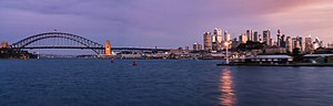 McMahons Point - Sydney Harbour, the Sydney Harbour Bridge and the Sydney city centre on the far right at twilight from McMahons Point.