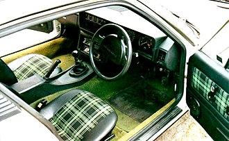 Triumph TR7 - Green tartan interior (with US spec. steering wheel center)