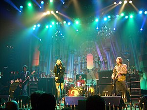 "Backline (stage) - The Black Crowes at the Hammerstein Ballroom, which has provided a backline of a number of powerful guitar amplifier ""heads"" and large speaker cabinets, including two 8x10"" cabinets for the bass guitarist."