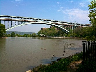 Harlem River - The Henry Hudson Bridge crosses the waterway at its west end.