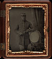 Three quarter length portrait, soldier with bass drum, holding sticks. Cased tintype, gutta percha case, ninth plate.jpg