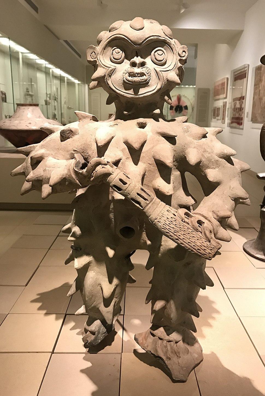 Tolita mythological figure in feathered costume IMJ B77.0161