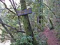 Trailhead marker pointing the way uphill from Alpine Lake along Cataract Creek towards Laurel Dell. - panoramio.jpg