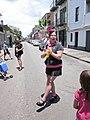 Tumblers at Pride 2010 Bourbon St poodle.JPG