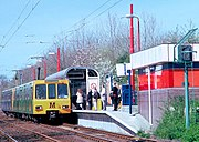 "A Tyne and Wear Metro train heading for South Shields calls at Kingston Park station. Although nominally ""light rail"" the high platforms and full segregation from roads and pedestrians places this system at the upper end of the transport genre which includes street trams."