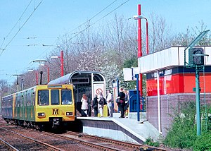 """A Tyne and Wear Metro train heading for South Shields calls at Kingston Park station. Although nominally """"light rail"""" the high platforms and full segregation from roads and pedestrians places this system at the upper end of the transport genre which includes street trams."""