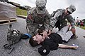 U.S. Army Capt. Mark Dutton, left, a physician assistant with the 351st Aviation Support Battalion, South Carolina Army National Guard, checks for a pulse on a simulated victim during Ardent Sentry 13 130519-Z-XH297-001.jpg
