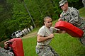 U.S. Army Pvt. William Bellassai, center, with the 1132nd Military Police Company, North Carolina Army National Guard, makes his way through a defense course during oleoresin capsicum familiarization training 130501-Z-AY498-023.jpg