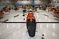U.S. Coast Guard MH-65 Dolphin helicopters from air stations in Mobile, Ala., New Orleans and Houston are brought inside the hangar at Air Station Houston for protection and routine maintenance in preparation 120828-G-EK967-008.jpg
