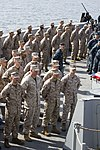U.S. Marines assigned to the 26th Marine Expeditionary Unit (MEU), and U.S. Sailors assigned to the USS San Antonio (LPD 17), stand in formation during the USS San Antonio's change of command ceremony on 130818-M-HF949-003.jpg
