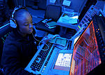 U.S. Navy Petty Officer 3rd Class Monique Diles monitors a ship self-defense system console aboard the aircraft carrier USS Nimitz (CVN 68) as the ship operates in the Pacific Ocean 121020-N-ZG290-029.jpg