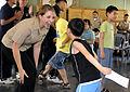 U.S. Navy Seaman Apprentice Jenna Welsh (left), assigned to the U.S. 7th Fleet command ship USS Blue Ridge (LCC 19), dances with Kim Young Min during a community service project at Cheonma Jaehwalwon 100824-N-XG305-289.jpg