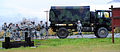 U.S. Soldiers, with the 545th Military Police Company, gather around a M1078A1R light medium tactical vehicle standard cargo truck as they arrive at the Kraft Range Hand Grenade Qualification Range on Joint Base 120920-F-LX370-213.jpg