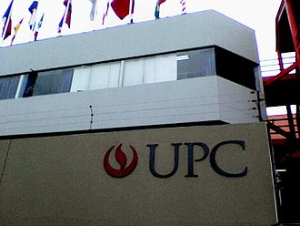 Peruvian University of Applied Sciences - Logo of UPC at the entrance of the parking lot at Santiago de Surco