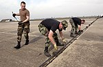 USAF personnel secure the Mobile Aircraft Arresting System cable in place during Cope India 2004.jpg