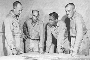1st Provisional Marine Brigade - Lemuel C. Shepherd (left) speaks with members of his staff during a planning meeting prior to the Guam operation. Next to him is 1st Brigade Chief of Staff John T. Walker, Alan Shapley (4th Marines) and Merlin F. Schneider (22nd Marines)