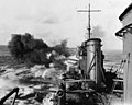 USS Salt Lake City (CA-25) bombarding a Japanese-held island in February 1942 (NH 50946).jpg