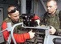 US Navy 021015-N-8859S-002 Readying the .50 cal machine gun.jpg