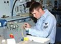 US Navy 030618-N-3970R-011 Aviation Electronic Technician 2nd Class Luke Rachel repairs a field amplifier.jpg