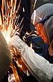US Navy 040129-N-7871M-001 Machinery Repairman Fireman Nicholas Crowe of Carthage, Texas, cuts open the outer door.jpg