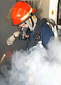 US Navy 040416-N-4565G-002 Damage Controlman 3rd Class Marc Hayford responds to a simulated Class Alpha fire.jpg