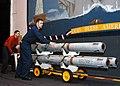 US Navy 040424-N-6278K-006 Aviation Ordnanceman Airman Joshua Graham, of Truckey, Calif., left, and Aviation Ordnanceman 1st Class Charles Carter, of Brunswick, Ga., transport AIM-7 Sparrow air-to-air missiles.jpg