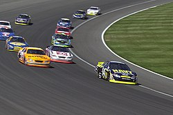 US Navy 040501-N-1336S-037 The U.S. Navy sponsored Chevy Monte Carlo NASCAR leads a pack into turn four at California Speedway.jpg