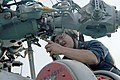 US Navy 040608-N-5663H-007 Aviation Machinist Mate 1st Class Tim Bozman, assigned to Light Helicopter Anti-Submarine Squadron Four Nine (HSL-49), performs maintenance on an SH-60B Seahawk.jpg