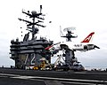 US Navy 040623-N-6817C-073 A T-45A Goshawk assigned to Training Air Wing Two (TW-2) attempts a touch and go landing on the flight deck aboard the Nimitz-class aircraft carrier USS Abraham Lincoln (CVN 72).jpg