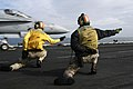 US Navy 040628-N-0119G-005 Lt. Cmdr. Michael Black, from Kings Park, N.Y., and Lt. Wesley Vinyard, from Mableton, Ga., give the signal to launch an F-A-18 Hornet.jpg