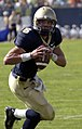 US Navy 040925-N-0962S-005 U.S. Naval Academy Midshipman 1st Class Aaron Polanco rolls out for a pass against Vanderbilt.jpg
