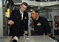 US Navy 041027-N-9860Y-004 Capt. J. Stephen Maynard describes Blue Ridge's communication systems to Japan Maritime Self Defense Force, Sasebo Region, Vice Adm. Seizo Nakao, during a tour of the ship's Joint Combat Information C.jpg