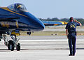 US Navy 041106-N-4779D-045 A crew chief assigned to the U.S. Navy flight demonstration team, the Blue Angels, salutes the pilot of his F-A-18A Hornet as he prepare for takeoff.jpg