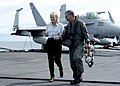 US Navy 050105-N-6817C-052 Journalist Diane Sawyer walks with Commander, Carrier Strike Group Nine (CSG 9), Rear Adm. Doug Crowder, on the flight deck aboard USS Abraham Lincoln (CVN 72).jpg