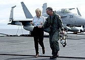 US Navy 050105-N-6817C-052 Journalist Diane Sawyer walks with Commander, Carrier Strike Group Nine (CSG 9), Rear Adm. Doug Crowder, on the flight deck aboard USS Abraham Lincoln (CVN 72).jpg