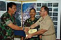 US Navy 050316-N-6665R-098 Commodore Conrad Divis, right, presents a certificate of appreciation to Operations Officer, Aceh Disaster Management Task Force, Indonesian Army Colonel Sunabowb Sandi.jpg
