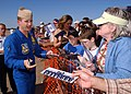 US Navy 050402-N-1328C-631 F-A-18A Hornet Slot Pilot, Lt. Cmdr. Max McCoy, assigned to the U.S. Navy flight demonstration team, the Blue Angels, signs autographs for fans during the Texas Thunder 2005 Air Show.jpg