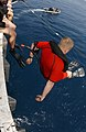 US Navy 050826-N-0413R-061 A search and rescue swimmer jumps off of a deck edge elevator during a swim call held aboard the nuclear-powered aircraft carrier USS Nimitz (CVN 68).jpg