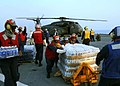 US Navy 050903-N-8002S-100 U.S. Navy flight deck personnel take part in an emergency replenishment working party aboard the dock landing ship USS Tortuga (LSD 46), as they load water into an MH-53E Sea Dragon helicopter.jpg