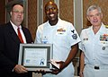 US Navy 051014-N-6639M-001 Aviation Ordnanceman 1st Class Carlos Young, assigned to the nuclear powered aircraft carrier USS Enterprise (CVN 68), is named the 2005 Samuel T. Northern Military Citizen of the Year.jpg