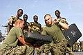 US Navy 051103-M-2175L-076 U.S. Marine Cpl. Dante Dipasqua and Cpl. Richard Hazenburg, both assigned to 2nd Platoon, Company C, 1st Battalion, 8th Marine Regiment, demonstrate the vertical hammer fist blow to members of the Sen.jpg