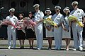 US Navy 060701-N-1332Y-094 Rear Adm. Doug McClain, USS Kitty Hawk (CV 63) Commanding Officer, Capt. Ed McNamee, Capt. Michael McNellis and Commander, Destroyer Squadron One Five, Capt. Robert Girrier, receive flowers as they ar.jpg