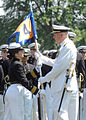 US Navy 070524-N-1026O-003 Midshipman 1st Class Jade Baum presents Naval Academy Superintendent Vice Adm. Rodney P. Rempt with the color company guidon during the Naval Academy Color Parade.jpg