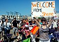 US Navy 070827-N-4007G-001 Friends and family members of Sailors aboard Nimitz-class aircraft carrier USS John C. Stennis (CVN 74) await the ship's arrival at Naval Air Station North Island.jpg