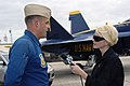 US Navy 071031-N-8102J-043 CBS television reporter Celine McArthur interviews Blue Angel's pilot Marine Corps Maj. Nathan Miller, ^7 pilot of the Blue Angels, prior to her media ride in a Blue Angels F-A-18 Hornet.jpg