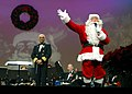US Navy 071215-N-0773H-132 Santa greets the audience and wishes everyone a Merry Christmas at Daughters of the American Revolution (DAR) Constitution Hall.jpg
