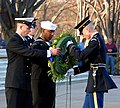 US Navy 080109-N-7948R-200 Machinist Mate Chief Phillip Wharton, left, and Machinist Mate 1st Class Jeffrey Harp, Commander, Navy Recruiting Command (CNRC) top two Recruiters of the Year (ROY), present a wreath from CNRC to the.jpg