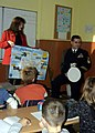 US Navy 081118-N-5483N-001 Chief Cryptologic Technician (Technical) Kevin Murphy, assigned to the amphibious command ship USS Mount Whitney (LCC 20), explains to 5th grade students at Secondary School Petko R. Slaveykov in Varn.jpg